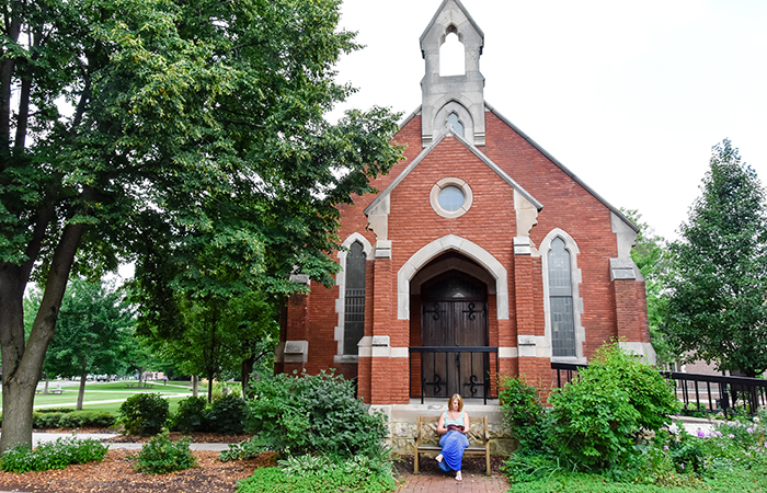 University of Dubuque Theological Seminary. A red-brick chapel surrounded by greenery.