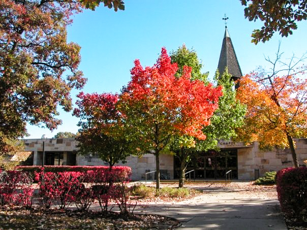 Trinity Evangelical Divinity School. Trees changing colors during fall in front of a chapel.